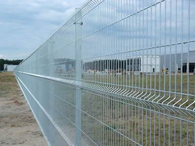 Several galvanized 3D security fences with three curves surrounding the factory.