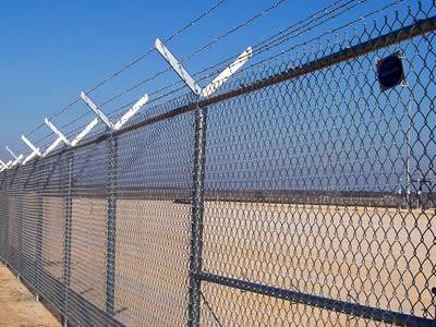 Anti-intruder chain link fence with double extension arm post is installed surround the yard.