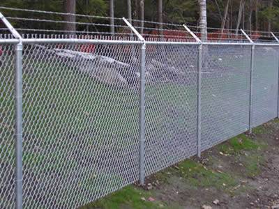 Anti-intruder chain link fence with inward post is installed surround the forest farm.