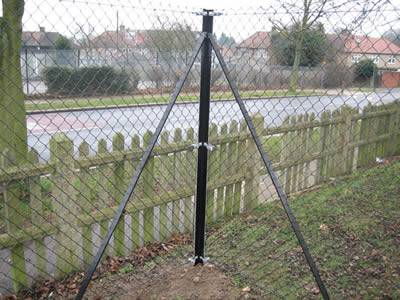 Chain link mesh with straining post is installed surrounding the yard.