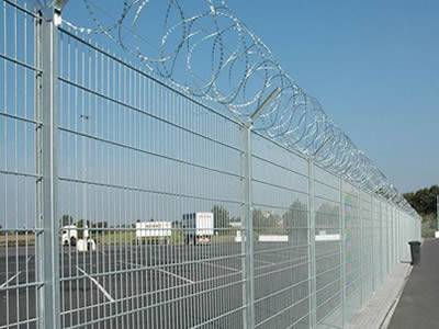 Several galvanized welded anti-intruder fences are installed in the parking lot.