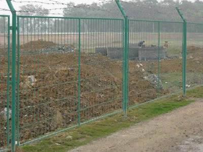Anti-intruder fences with inward cranked intermediate posts.