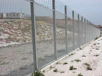 Anti-intruder fences with straight intermediate posts.