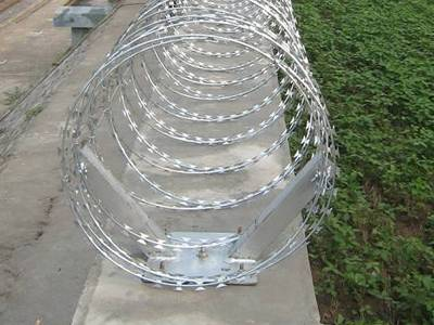 The concertina razor wire is installed onto the holder on the wall.