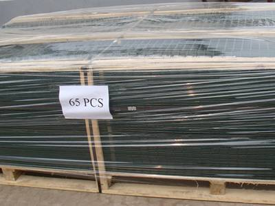 65 pieced of green PVC coated welded wire panels wrapped in plastic film and then packaged on wooden pallet