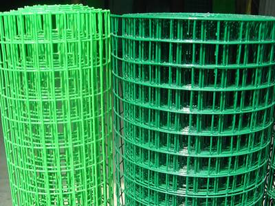 Two rolls of PVC coated welded wire mesh, one roll green, another light-green color.