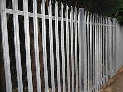 Galvanized palisade fences are installed surrounding the park.