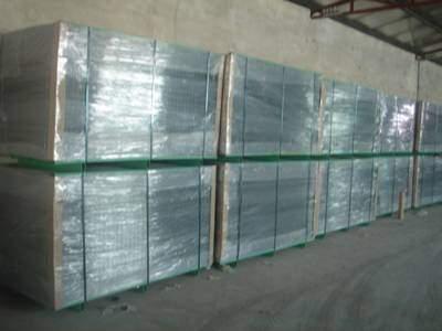 Reinforcing steel bar welded mesh panels in wooden pallet package and wrapped in plastic film, tied with green wires