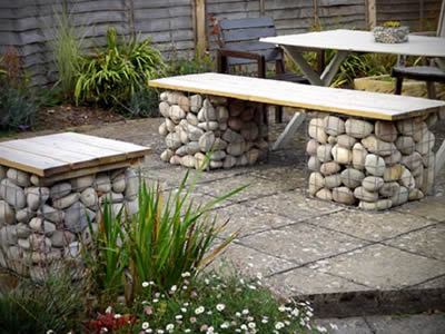 Table, bench made of welded gabion in the backyard.