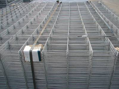 A bundle of galvanized welded reinforcing concrete meshes.