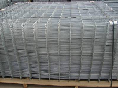 A wooden pallet of welded reinforcing concrete meshes.