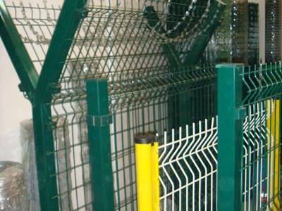 Green and white welded wire fence, fence post and concertina wire fence in our exhibition hall.
