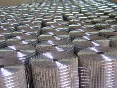Galvanized welded wire screen rolls in warehouse